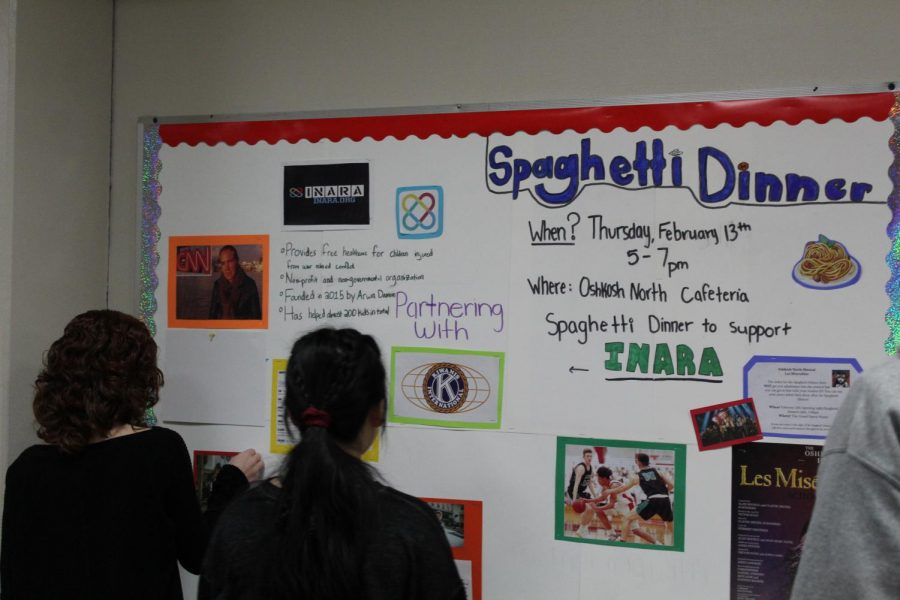 Communities+students+work+on+a+display+board+in+preparation+for+the+Spaghetti+Dinner+to+raise+funds+for+children+of+war.
